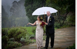 wedding picture of bride in rain